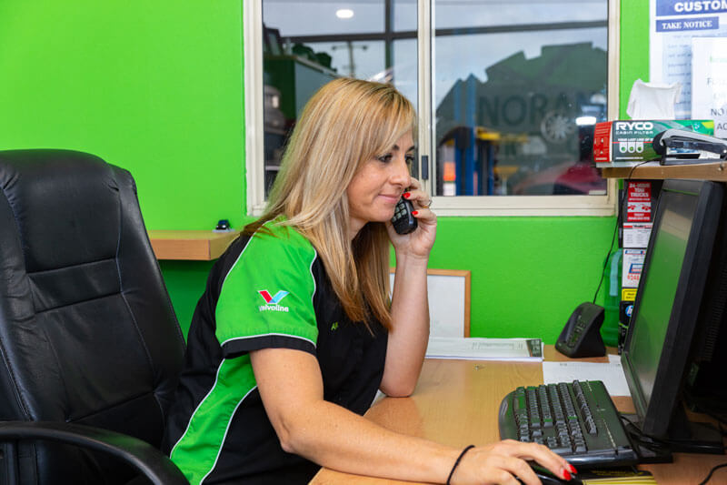 Noranda Service Centre - Car Auto Services Contact Image - Reliable Auto Shop Co-Owner Anne on the Phone