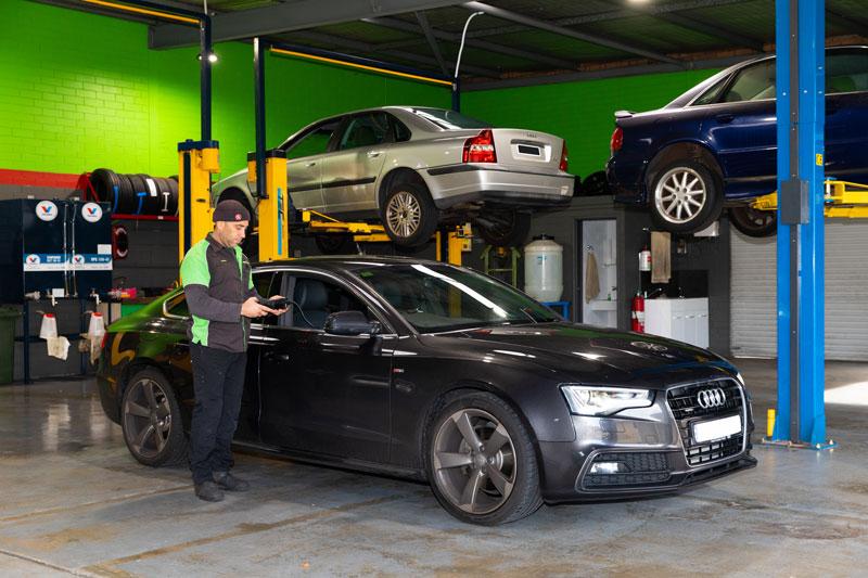 Noranda Service Centre Gallery Images - Car Checkup Using Gadget on Black Audi Car