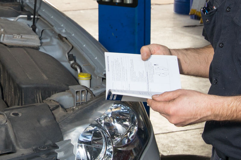 Noranda Service Centre Gallery Images - Car Logbook Services Mechanic Checking on the Record