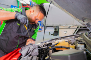 Noranda Service Centre Gallery Images - Checking of Car Engine Oil by Mechanic