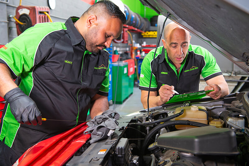 Noranda Service Centre Gallery Images - Checking of Car Engine Oil by Mechanic with the Checklist