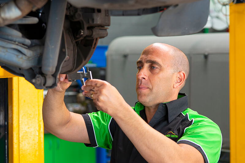 Noranda Service Centre Gallery Images - Mechanic Checking of Car Brake with Guage