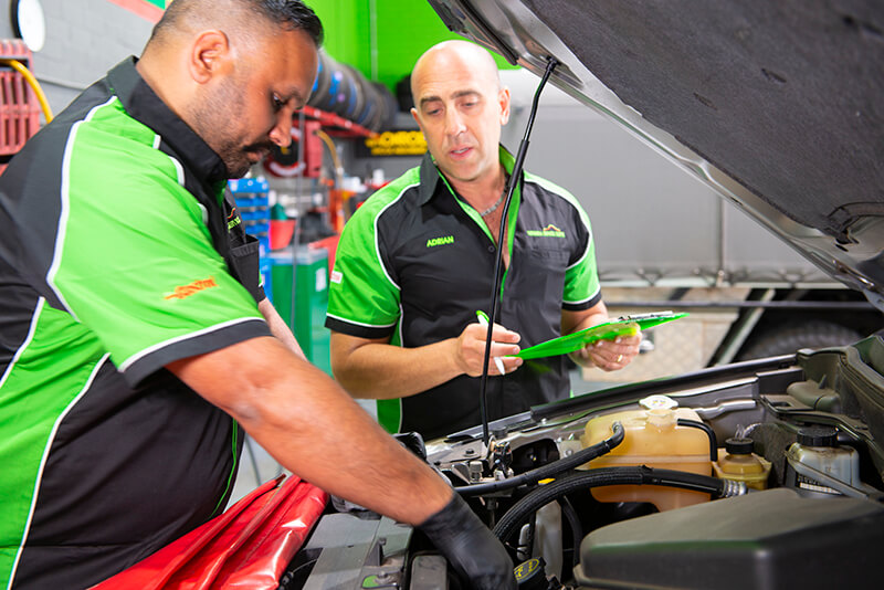 Noranda Service Centre Gallery Images - Mechanic Checking of Car Engine with Supervisor on Checklist