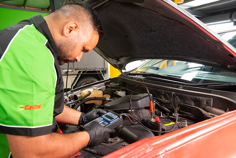 Noranda Service Centre Gallery Images - Mechanic Checking on Car Battery Using Voltmeter