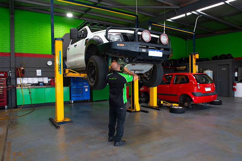 Noranda Service Centre Gallery Images - Mechanic Working on Off Road Vehicle