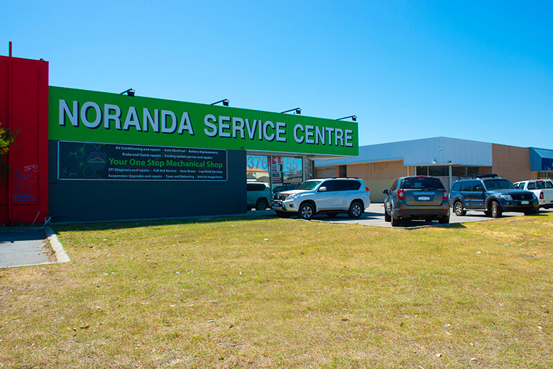 Noranda Service Centre Gallery Images - Noranda Service Centre View from the Parking and Grass with Sinage