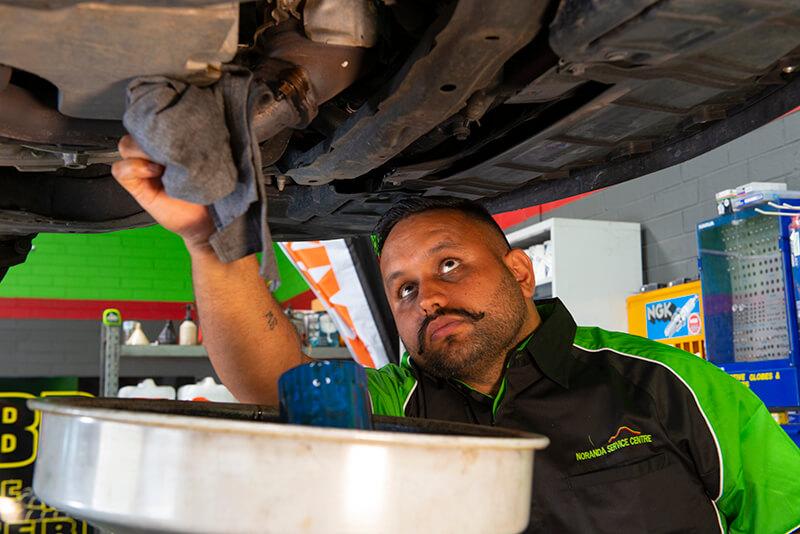 Noranda Service Centre Gallery Images - Preparing for Car Change Oil - Car Raised