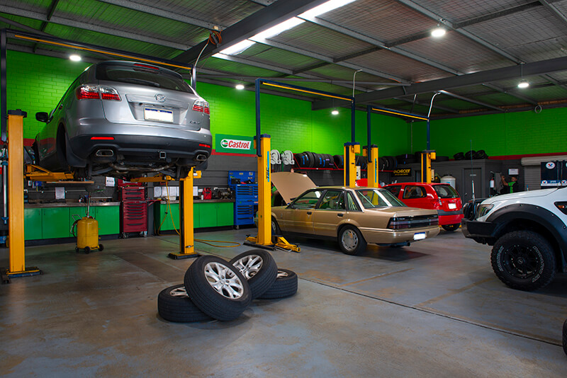 Noranda Service Centre Gallery Images - Services Grey Mazda Car with Wheels Taken Off on the Floor