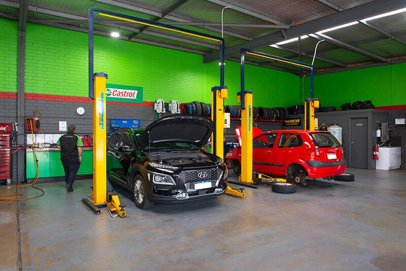 Noranda Service Centre Gallery Images - Servicing Black Hyundai and Red Car