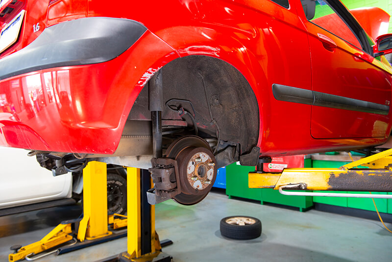Noranda Service Centre Gallery Images - Servicing of Red Car Wheels Taken Off