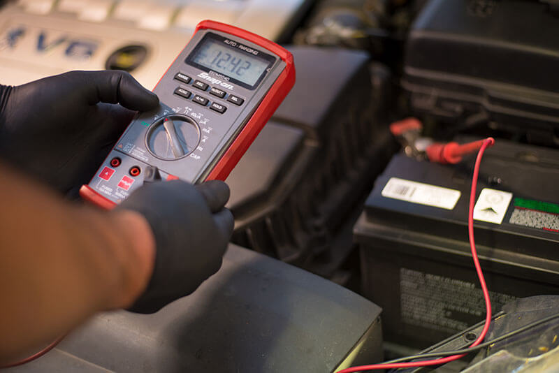 Noranda Service Centre Gallery Images - Vehicle Electricity Checking - Battery Checked with Voltmeter
