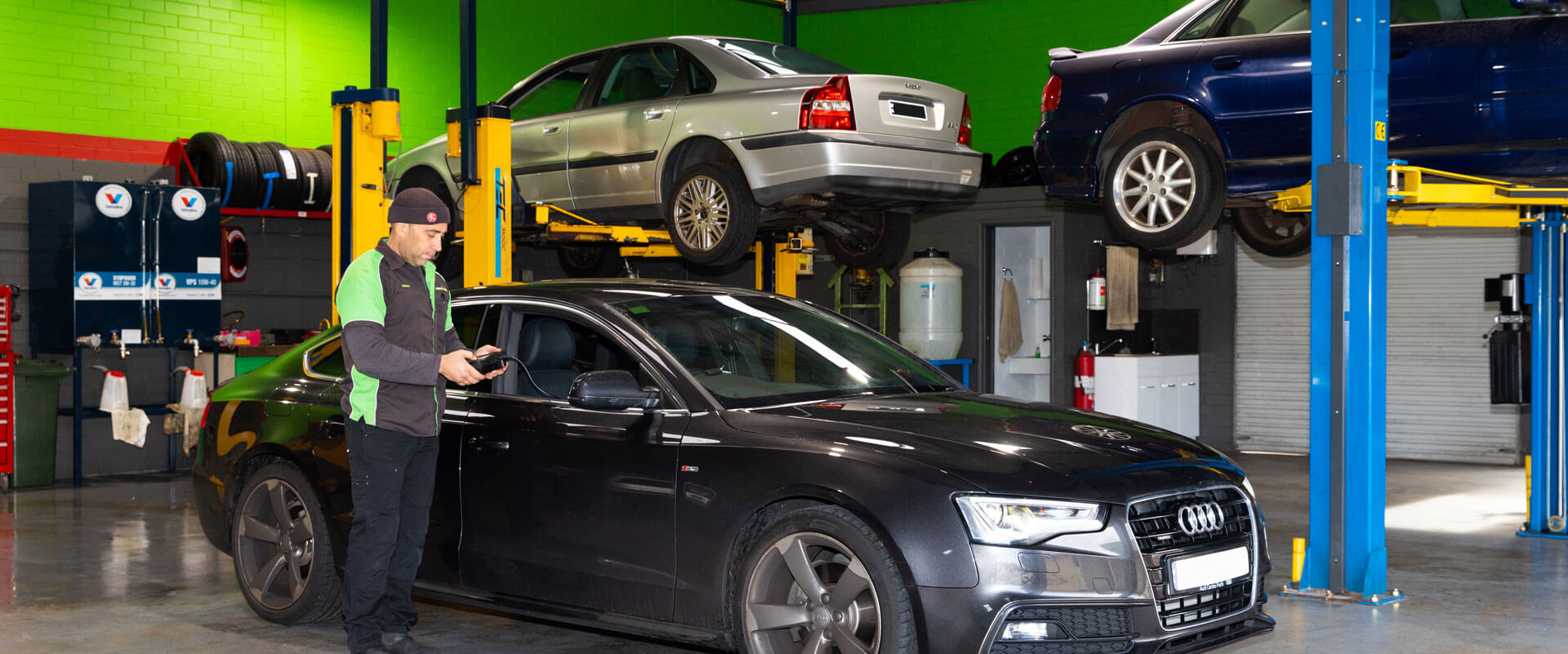 Noranda Service Centre Homepage Image - Mechanic Checking Car with Mechanic Gadget