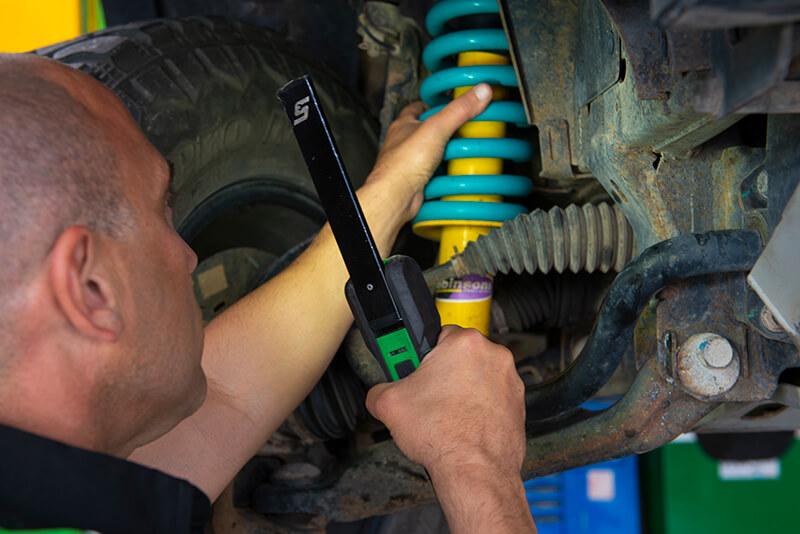 Noranda Service Centre Services - Car Auto Steering and Suspension - Car Auto Steering and Suspension Checking with Torch